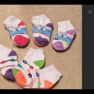 12pr of brand new socks size 2-4; fits babies 6-2T